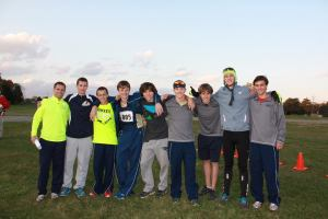The varsity cross country boys group together for a picture shortly after receiving their medals.