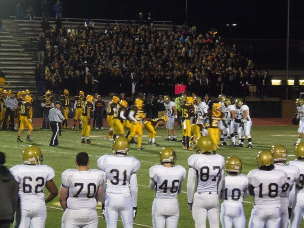 Cougars lining up on offense against the Rochester Adams Highlander's defense. Photo by Megan Sennett