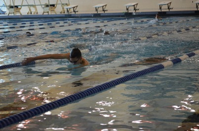Varsity swimmer caught in mid stride.