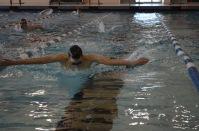 Varsity swimmer captured breathing during the breathstroke