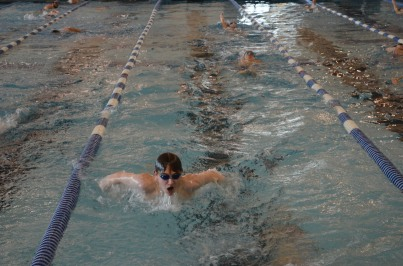 Swimmer taking an aggresive breath during practice.
