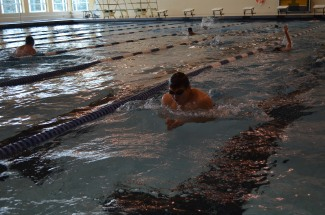Swimmer mid stroke during warm ups.