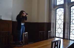 Senior Caitlin Tanner snaps a photo of the architecture of Cranbrook. She found many photography opportunities while on the trip. (Photo by Erika Williams)
