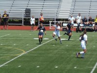 Senior Madison Schupbach and junior Jamie Midgley pushing the ball up the field against Eisenhower's defense.